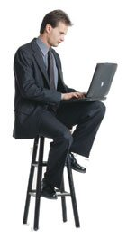 Man on a Stool With a Laptop